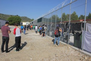 At the fence inside of the detention center. Copyright: Azadi
