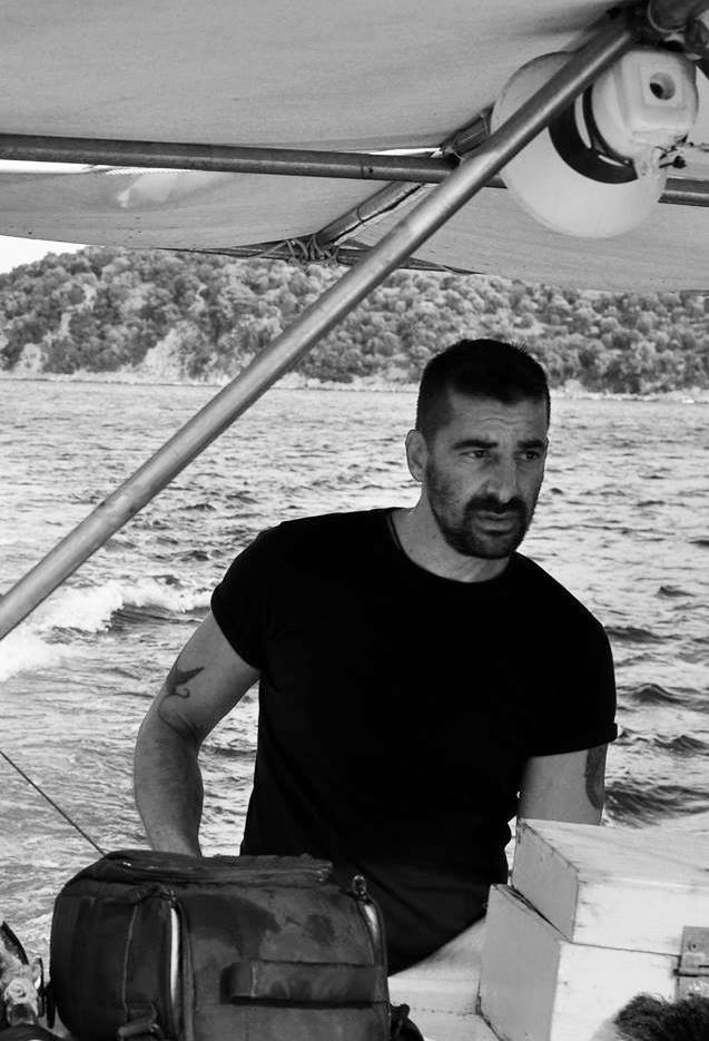 Photo of Stratos on his boat during a beach clean by Lighthouse Relief volunteer Samuel Nacar